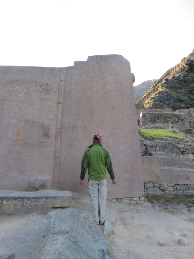 A visitor to Ollantaytambo, in the Sacred Valley of Peru, absorbing the energy there