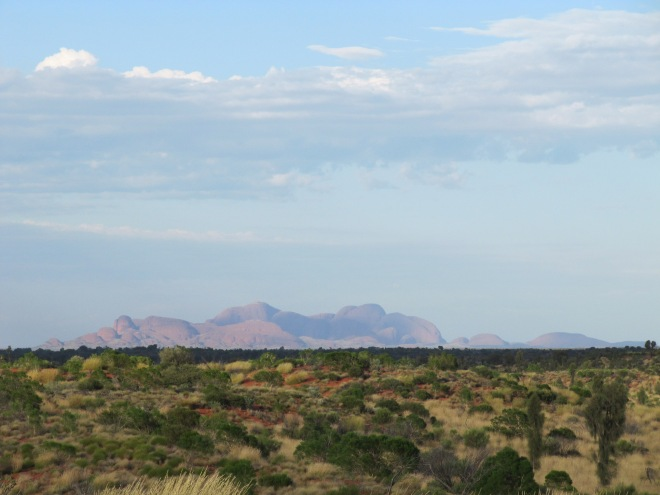 The beautiful shape and presence of Kata-Tjuta on the horizon, a sacred site for Indigenous Australians