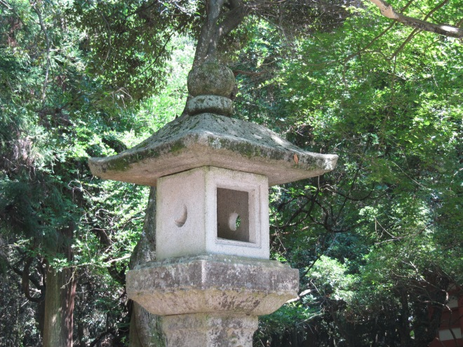 Both the sun and the moon are important in the rituals of Japan. They are both seen on this stone lantern at Nara, at least that's what I understand the crescent and circle illustrate.