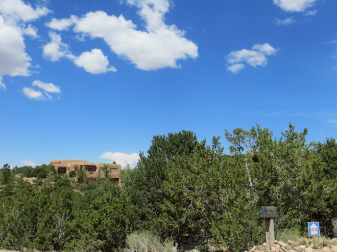 The low rise adobe (mud brick) buildings of Santa Fe blend into the landscape.