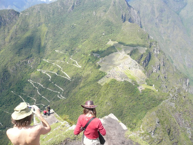 Machu Picchu and the pathway to the Gate of the Sun (far left), viewed from Waynu Picchu. The zig-zag road makes access easier, but detracts from the original.