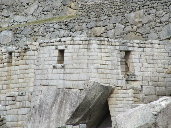 Buildings such as the Torreon at Machu Picchu were built around existing rocks. This image shows both the fine and coarser stone work of the Inka.
