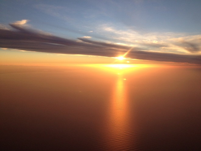 Flying into northern Tasmania can provide some magical moments of the sun setting on Bass Strait.