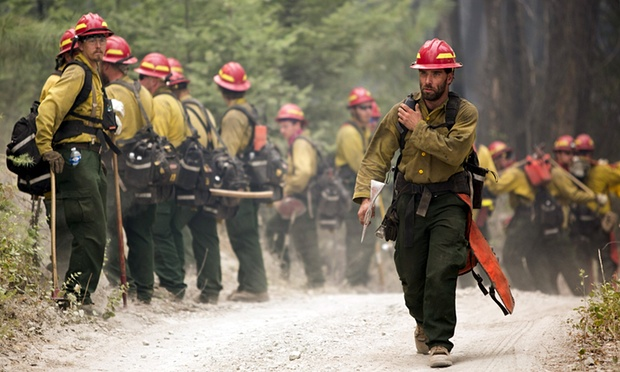 Members of a crew prepare to work on an area of unburnt brush in the Okanogan fires near Tonasket, Washington, on 22 August 2015. Photograph: Jason Redmond, the guardian.com