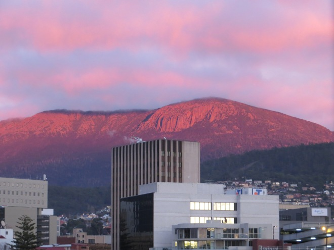 "In this image kunanyi/Mt Wellington has a fiery glow. Professor David Bowman has described the mountain as ""an organic volcano waiting to burn."" The last time it did so in a major way was in 1967."