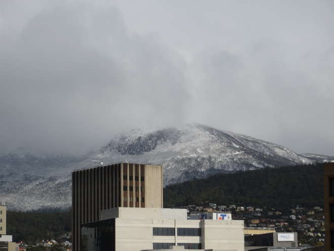 "Here the snow on kunany/Mt Wellington can be seen in the context of Hobart, the city it overlooks. ""The Mountain"" as it is often called, promotes a strong sense of place for many who experience its presence."