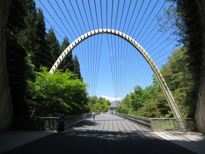 "The Miho Museum in Shiga Prefecture Japan was designed by I.M. Pei, a Chinese-born American. The design of the entrance to the museum was inspired by the Chinese expression ""Peach blossom spring beyond mortal world."" When you emerge from the tunnel that leads to the museum you see a grand space with the buidlings embedded in the mountain."