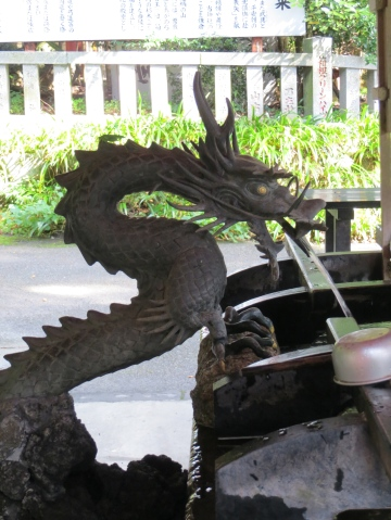 Dragon shaped water fonts are often found at Shinto Shrines signifying a strong connection with water. This dragon is delivering water to the chozubachi at at Hakone Shrine.