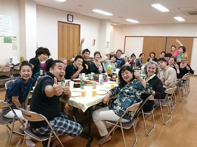 Sharing food is one of the delights of life, something that crosses cultures. Here food is being shared between members of two Japanese and one Australian taiko group.