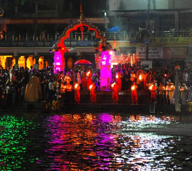 Aarti, or offering prayers, on the banks of the River Khrispha. Millions throng the Ghats or the River Banks ( Please see the featured Image) and sing in unison daily during the entire month. Source: A River Worshipped' by Mukul Chand.