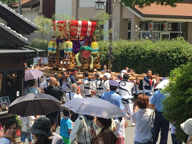 The festival is a community event with two floats involved, both containing a frog. One involved the children of the area surrounding the temple. The other float, shown here, was carried past and then to the temple by a group of local men.
