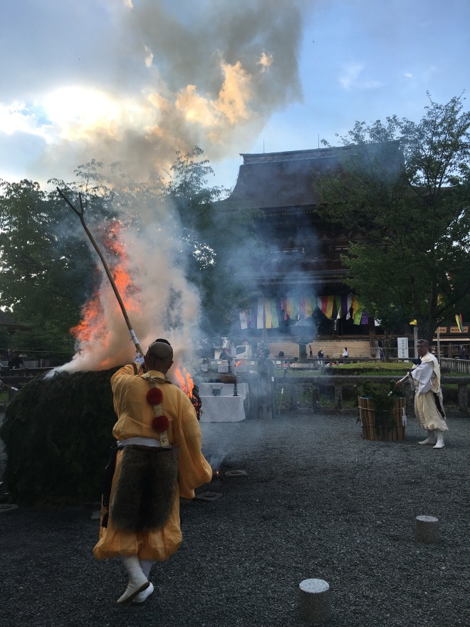 Here the saito-shi is tracing a letter symbolic of the Mahavairocana Buddha over the fire. Water is sprinkled periodically to prevent the fire from burning too quickly and to increase the purifying smoke. Further details of the ceremony can be found in an informative article by Paul L. Swanson written in 1981.