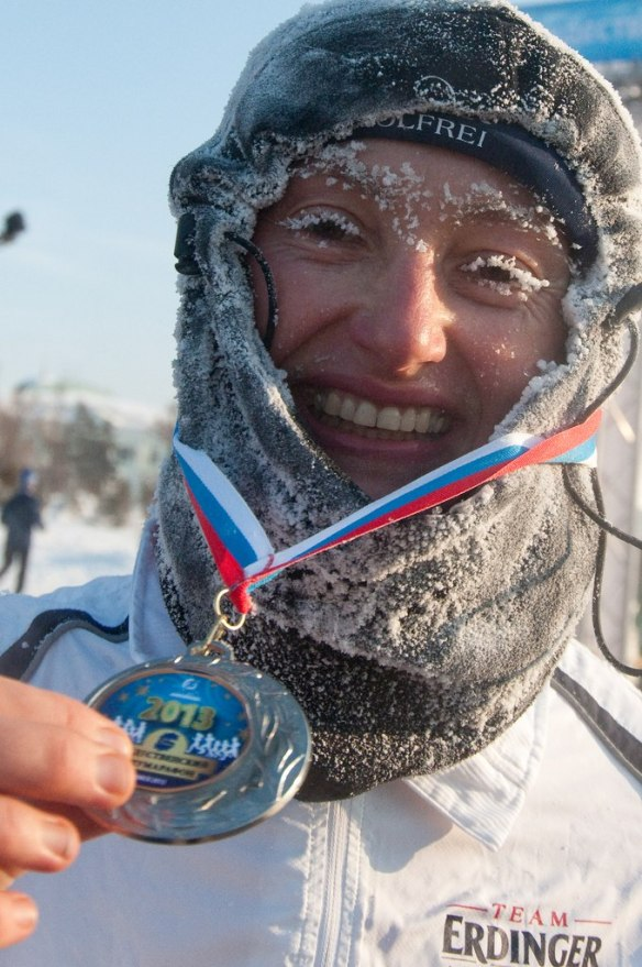 A joyous image of a runner in the 2013 Siberian Ice marathon from www.runsim.au. While many people take shelter and slow down during cold periods, these runners embrace the icy elements. Some even immerse themselves in freezing water after the race. They are really cool dudes!